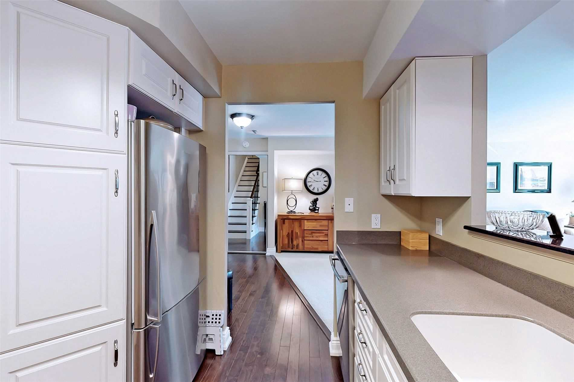 Image 4 of 40 showing inside of 2 Bedroom Condo Apt 2-Storey for Sale at 25 Cumberland Lane Unit# 105, Ajax L1S7K1
